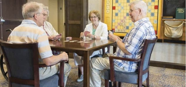residents playing cards - Louisville senior living
